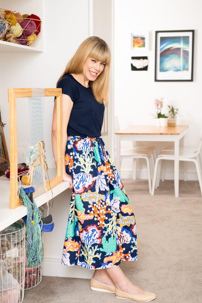 artist standing in her studio